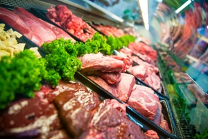 Red meat in a refrigerated display case